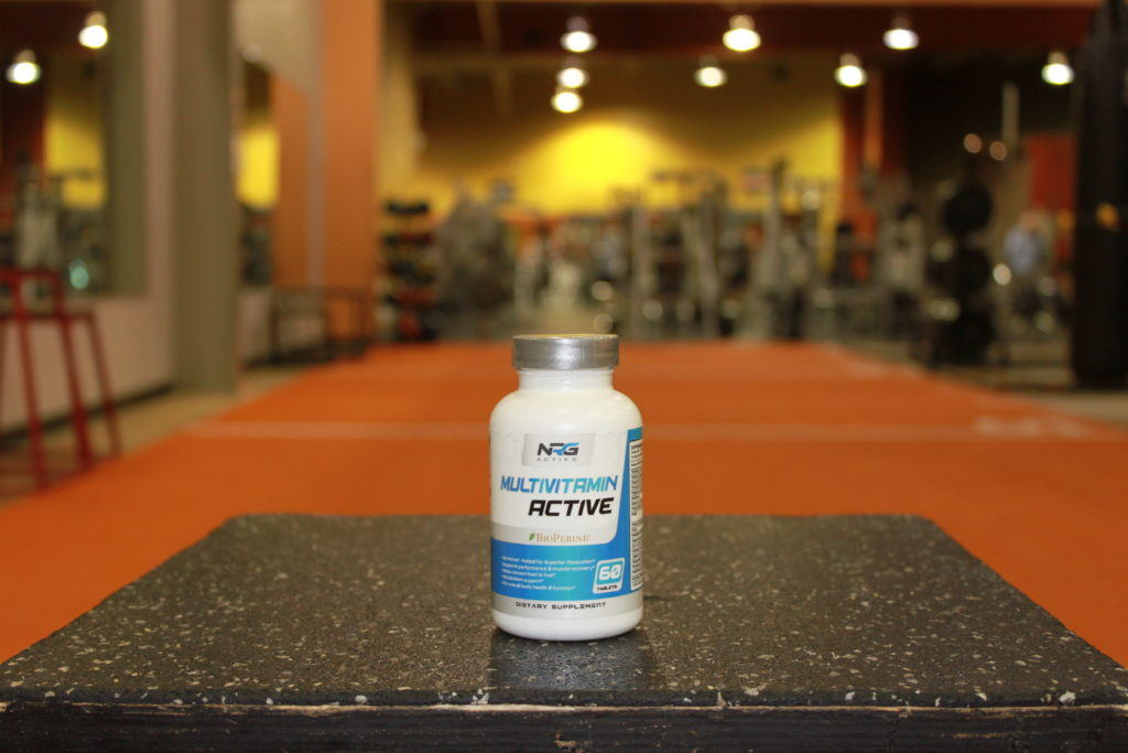 multivitamin bottle on table in gym